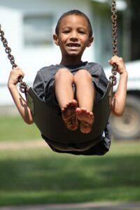 kid-swinging-long--island-park